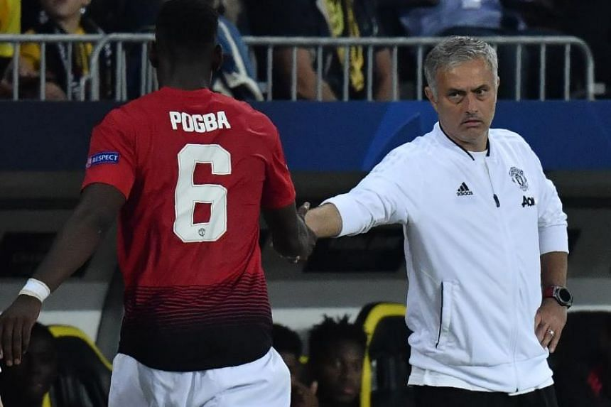Manchester United midfielder Paul Pogba (left) shakes hands with manager Jose Mourinho after his substitution during the Uefa Champions League group H match against Young Boys at The Stade de Suisse in Bern on Sept 19, 2018.