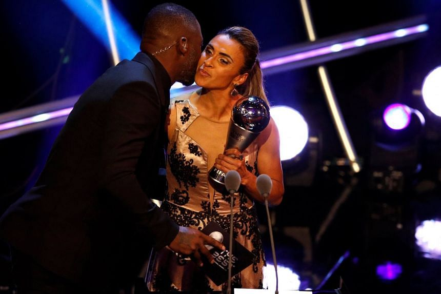 Host Idris Elba kissing Marta after handing her the Best Women's Player award at The Best Fifa Football Awards at Royal Festival Hall in London on Sept 24, 2018.