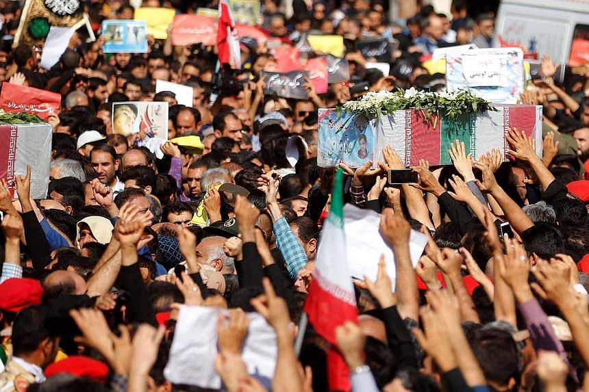 Thousands of people packed the streets of Ahvaz yesterday to mourn the victims of an attack on a military parade in the Iranian city last Saturday. The coffins, wrapped in the flag of the Islamic Republic, were carried through the streets by the mour