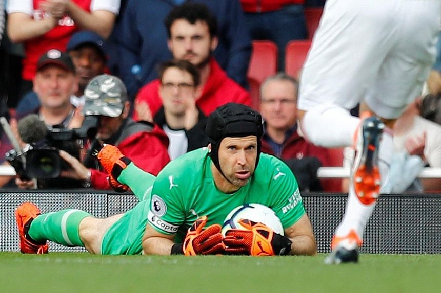Petr Cech showed a safe pair of hands in Arsenal's 2-0 Premier League home win over Everton on Sunday, as manager Unai Emery celebrated his team's first clean sheet of the season.