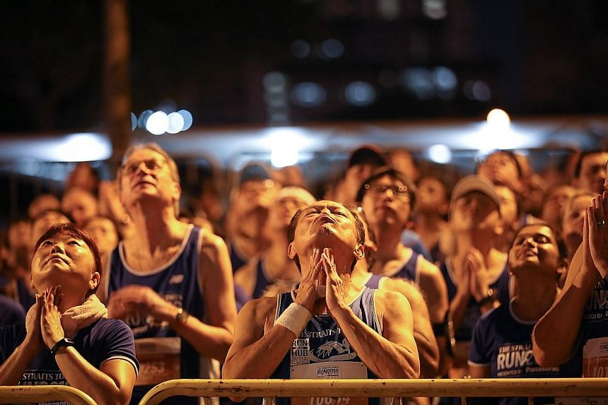Top row (from left): Participants stretch before the 10km run. Pacers for the 18.45km run getting into the mood before the start. Centre row (clockwise from left): 10km runners dressed in Superman and Wonder Woman garb along Nicoll Highway. A runner