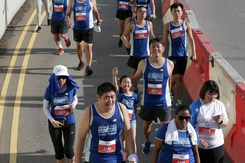 Runners running along Stadium Road during the ST Run on Sept 23, 2018.
