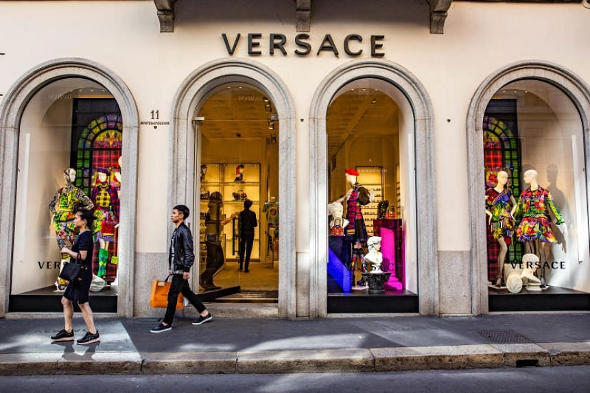A customer leaves a Gianni Versace SpA store in Milan, Italy, on Sept 24, 2018.