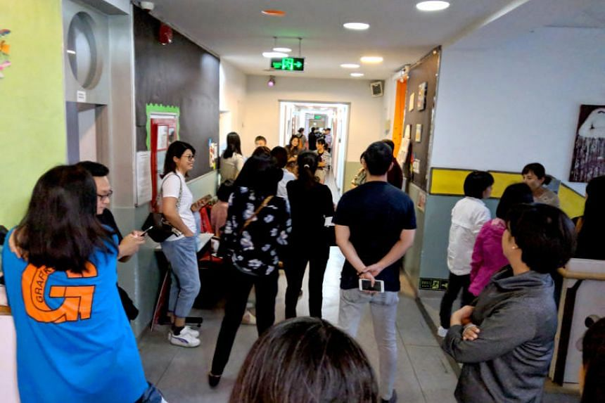 Over 30 parents turned up at the Singaporean-run Beijing BISS International School on Sept 25, 2018, demanding answers from the school's management after teachers refused to work last week because they had not been paid.