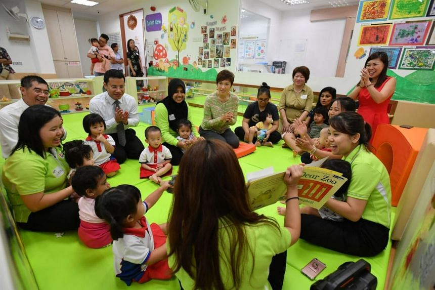 Minister for Social and Family Development Desmond Lee and Manpower Minister Josephine Teo interacting with the children.
