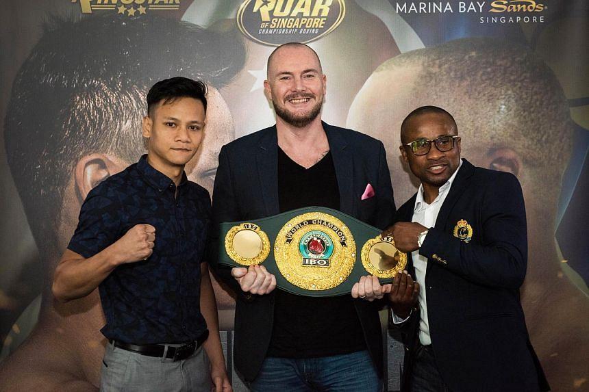Muhamad Ridhwan will face Namibia's Paulus Ambunda for the vacant International Boxing Organisation super bantamweight world title. With them is Ringstar founder Scott O'Farrell.