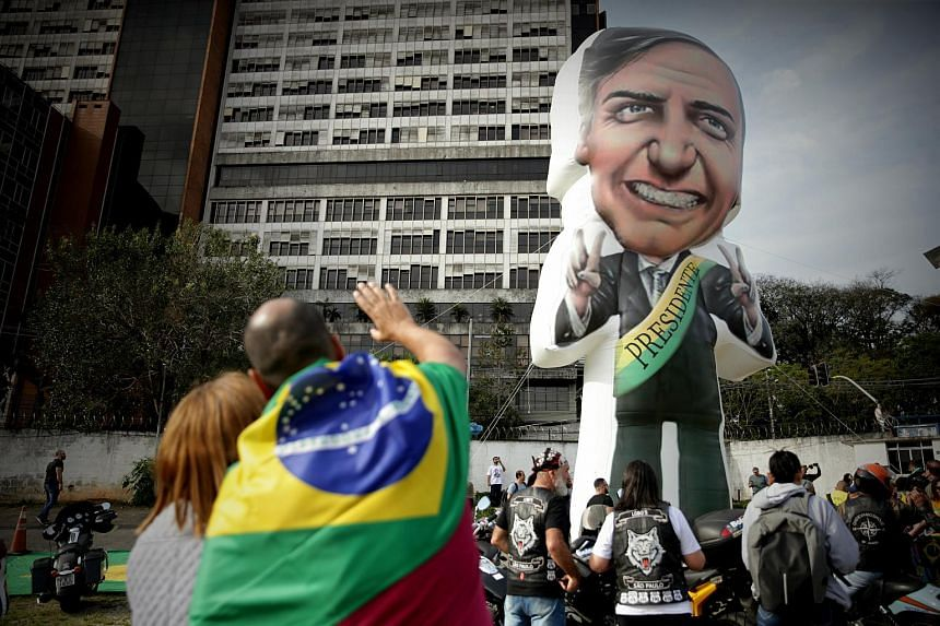 Supporters of presidential candidate Jair Bolsonaroparticipate in a rally outside the Albert Einstein Hospital in Sao Paulo, Brazil, on Sept 16, 2018.