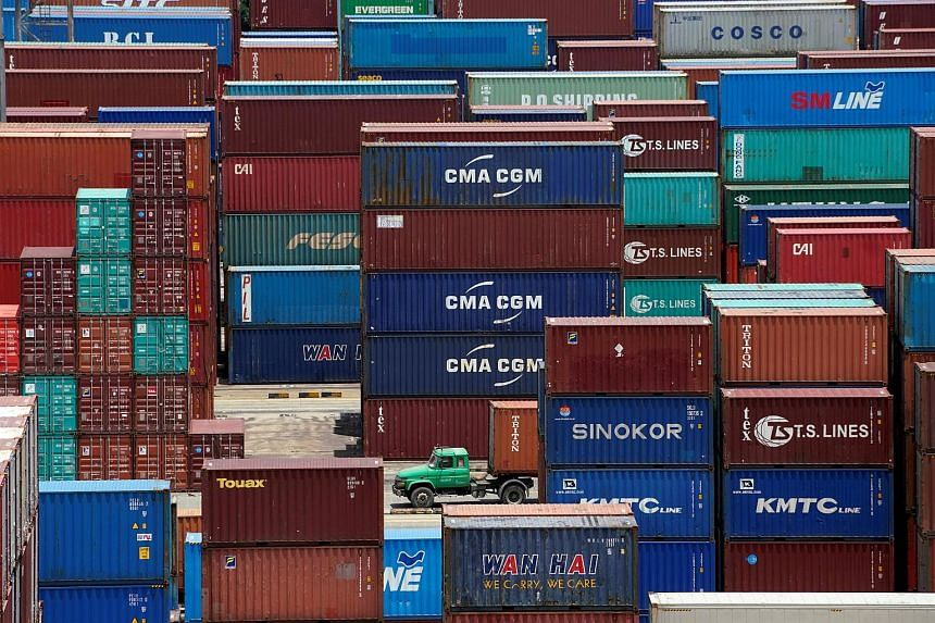 Shipping containers seen at a port in Shanghai, China, on July 10, 2018.