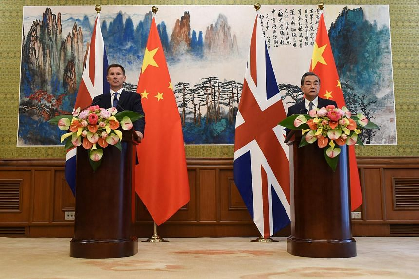 Britain's Foreign Secretary Jeremy Hunt (left) and China's Foreign Minister Wang Yi at a joint press conference at the Diaoyutai State Guesthouse in Beijing, on July 30, 2018.