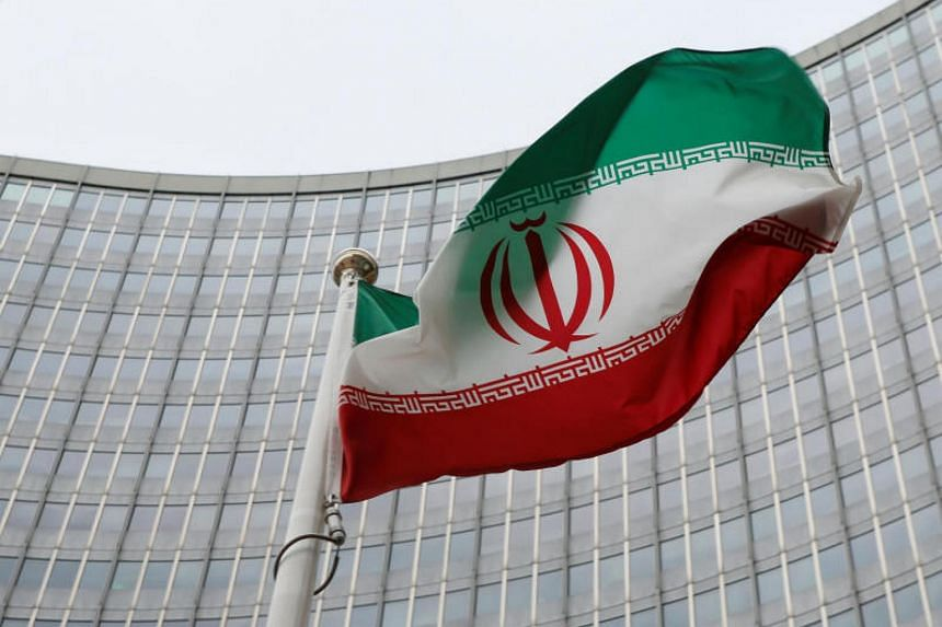 An Iranian flag flutters in front of the International Atomic Energy Agency headquarters in Vienna, Austria.