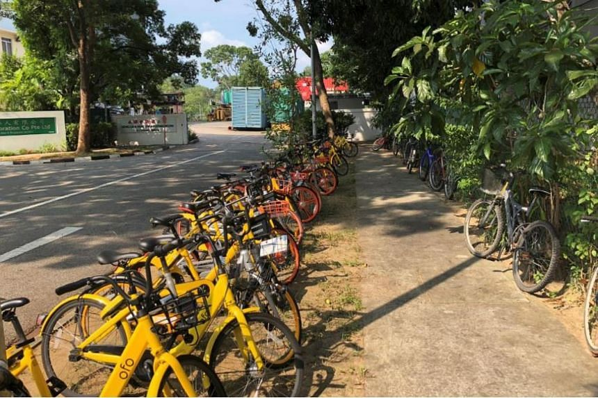 Bicycles parked haphazardly in Loyang Way.