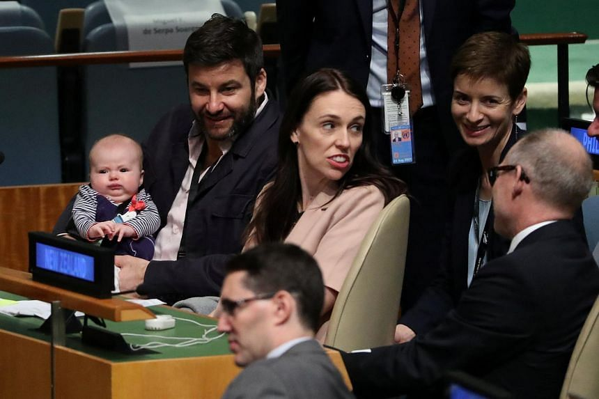 New Zealand Prime Minister Jacinda Ardern sits with her baby Neve before speaking at the Nelson Mandela Peace Summit during the 73rd United Nations General Assembly in New York.