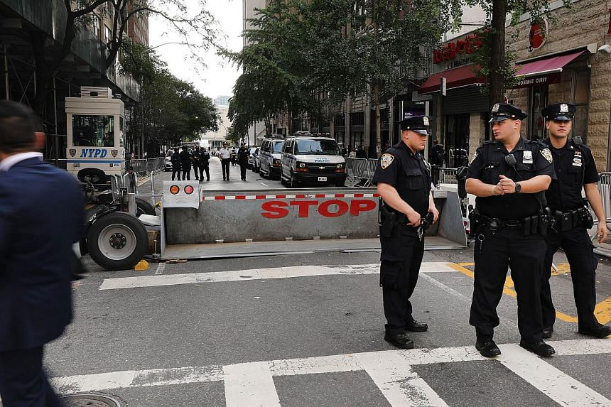 Policemen standing guard outside the United Nations building in New York City, on Sept 24, 2018.