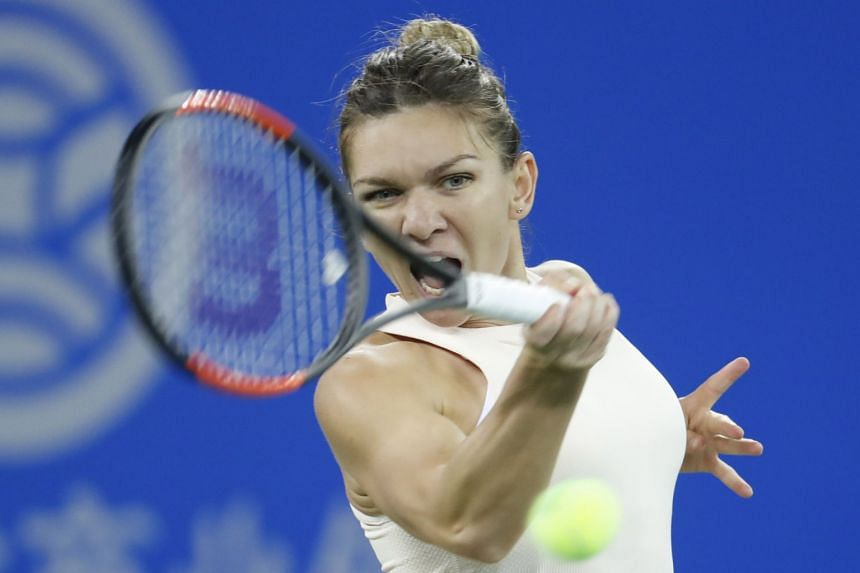 Halep in action during her second-round match against Dominika Cibulkova of Slovakia.