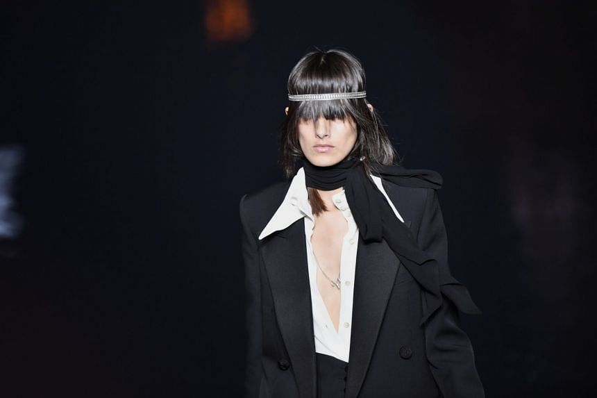 A model presents a creation by Belgian designer Anthony Vaccarello for Yves Saint Laurent.