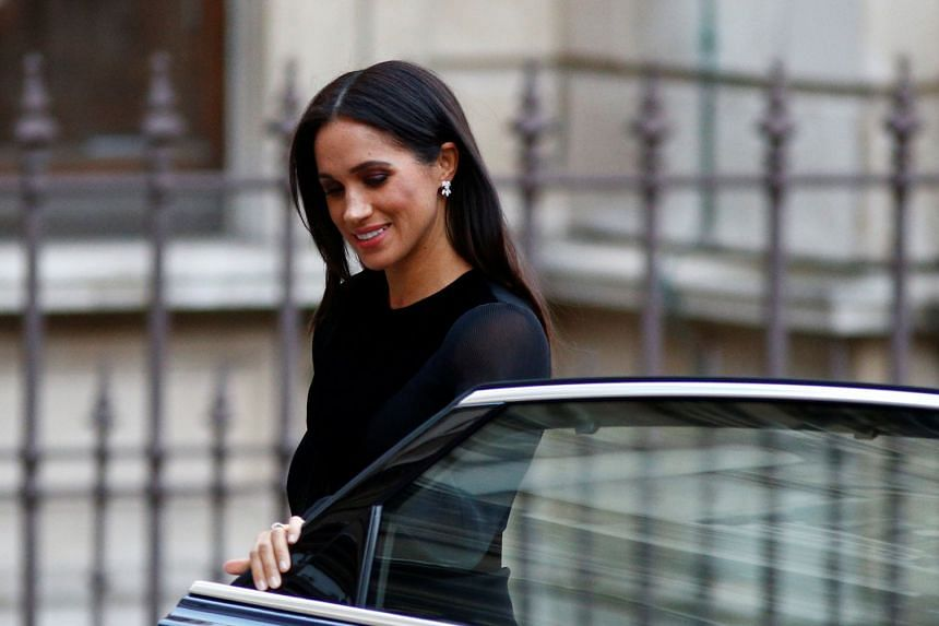 """Britain's Meghan, the Duchess of Sussex, arrives at the opening of """"Oceania""""."""