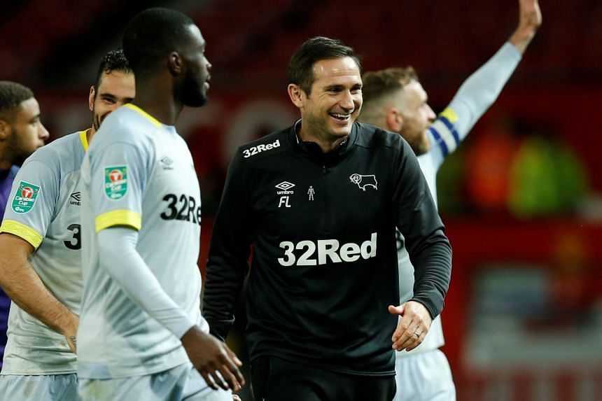 Derby County manager Frank Lampard celebrates winning the penalty shootout.