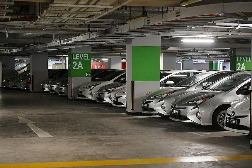 Lion City Rentals has been putting up its unhired cars for bidding by rental fleet owners and used car dealers. Several hundred of its cars are parked in places such as Big Box Singapore, Carros Centre and Sports Hub (above).