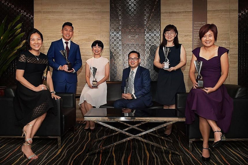SPH staff who received awards at the Sias Investors' Choice Awards: (from left) Business Times senior correspondent Angela Tan; Lianhe Zaobao business correspondent Wong Kang Wei; Lianhe Zaobao correspondent Tang Ai Wei; chief financial officer Chua