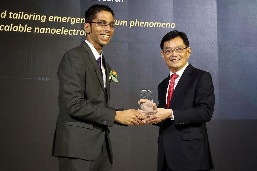 Above: Dr Anjan Soumyanarayanan of A*Star's Institute of Materials Research and Engineering receiving the Young Scientist Award from Finance Minister Heng Swee Keat. He was one of three winners of the prize. Left: Professor Lam Khin Yong receiving th