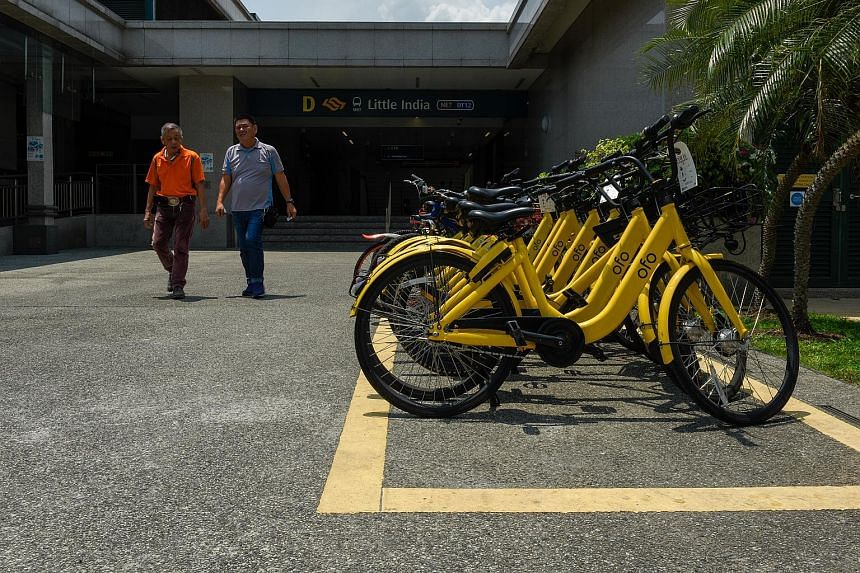 Bicycles parked neatly within the parking space outside Little India MRT station yesterday. To make sure that users park their shared bicycles properly, the Land Transport Authority said that it will start installing QR codes at such public bicycle p