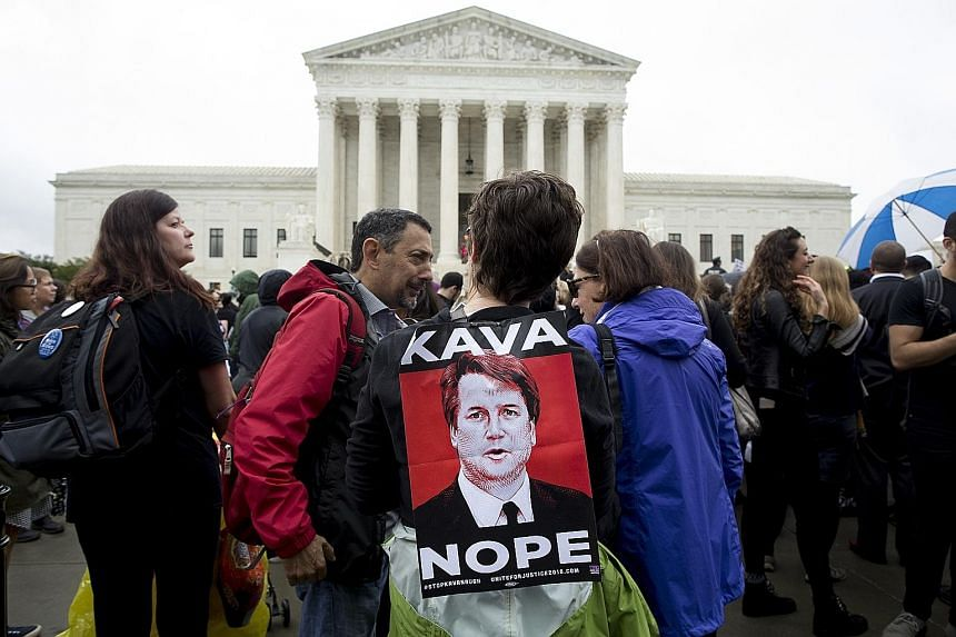 Protesters demonstrating against Mr Brett Kavanaugh's nomination to America's highest court outside the Supreme Court on Capitol Hill in Washington on Monday.
