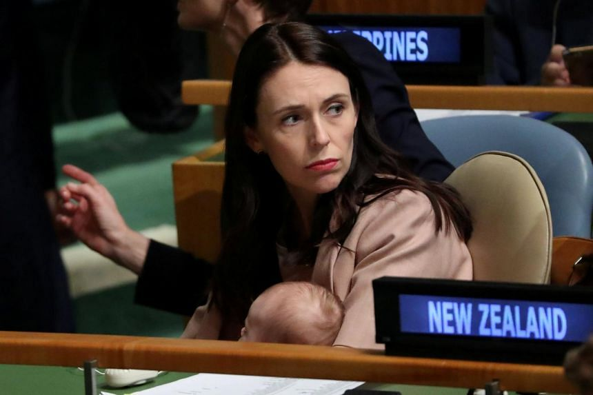 New Zealand Prime Minister Jacinda Ardern holds her baby in the General Assembly Hall during the United Nations General Assembly in New York on Sept 24, 2018.