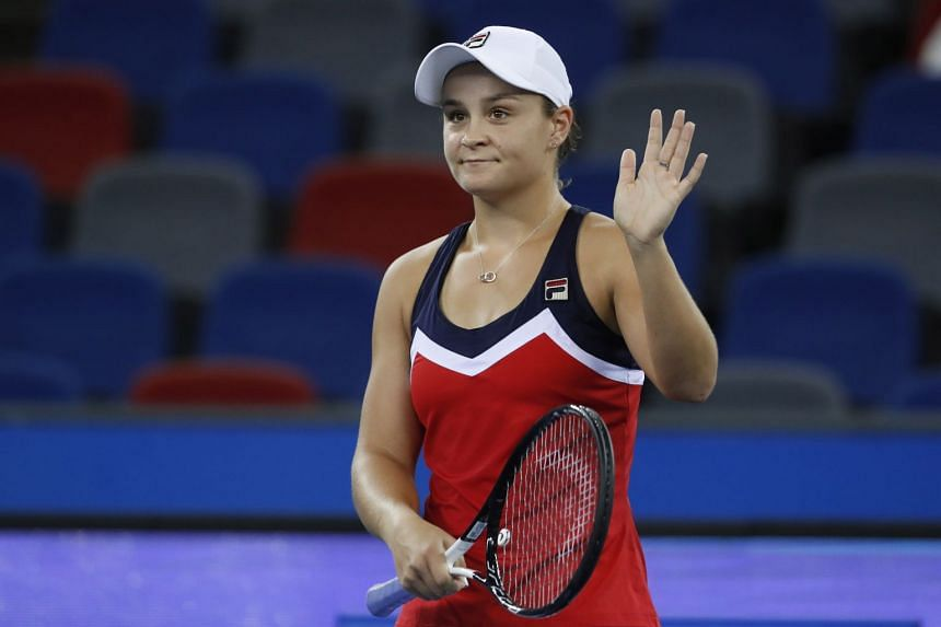 Australia's Ashleigh Barty celebrates after defeating Germany's Angelique Kerber during their match at the 2018 WTA Wuhan Open tennis tournament in Wuhan, China, on Sept 26, 2018.