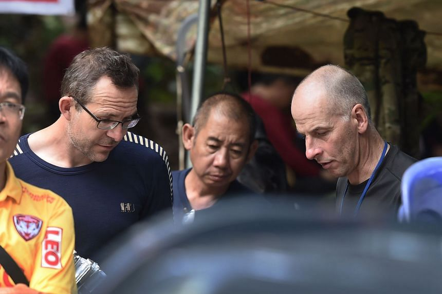 British divers John Volanthen (from left) and Richard William Stanton seen with Thai rescue personnel at the Tham Luang cave area at Khun Nam Nang Non Forest Park, on July 3, 2018.