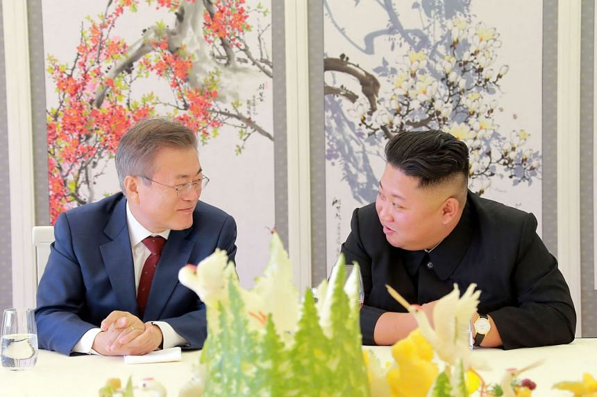 South Korean President Moon Jae-in (left) has portrayed North Korea's Kim Jong Un as a normal world leader who wants to bring economic prosperity to his people.