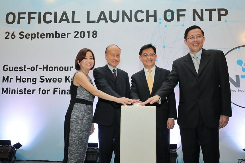 (From left) Ms Serene Ho, Director of the Networked Trade Platform Office; Dr Tan Kim Siew, co-chair of the National Trade and Logistics Inter-Agency Steering Committee; Finance Minister Heng Swee Keat; and Mr Ho Chee Pong, Director-General of Singap