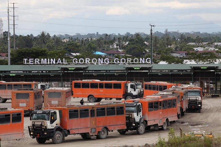Vehicles used for transporting workers to the Grasberg copper mine are seen at the Gorong-Gorong terminal in Timika, Mimika, Papua province, on Nov 16, 2017.