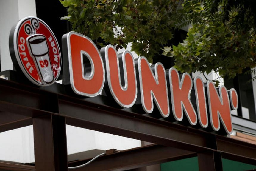 File photo of a Dunkin' sign at a store in Pasadena, California, US, on Aug 2, 2017. The US chain will still sell doughnuts, but will feature a new logo on packaging, store signage and advertising.
