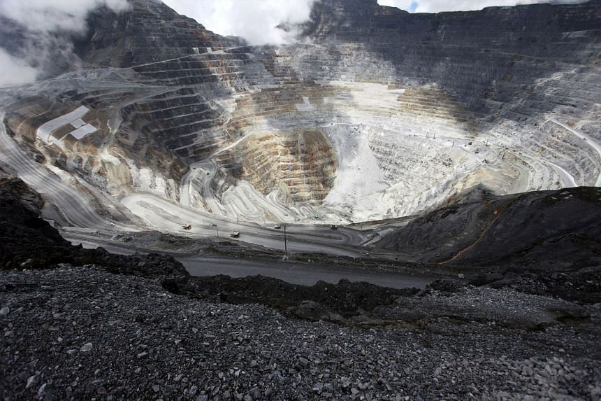 File photo of trucks operating in the open-pit mine of Freeport's Grasberg copper and gold mine complex near Timika, in the eastern region of Papua, Indonesia.