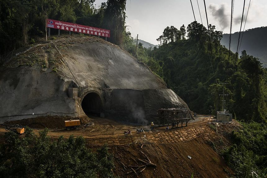 File photo of Chinese workers at the entrance to a tunnel they are building for the China Laos railway project near Vang Vieng, Laos, on May 8, 2017.
