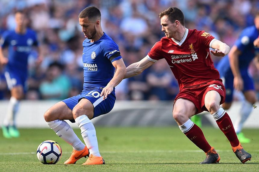 Liverpool's Scottish defender Andrew Robertson (right) vies with Chelsea's Belgian midfielder Eden Hazard during the English Premier League football match between Chelsea and Liverpool at Stamford Bridge in London, on May 6, 2018.