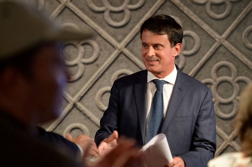 Valls shakes hands with supporters after announcing that he will run for the mayorship of Barcelona.