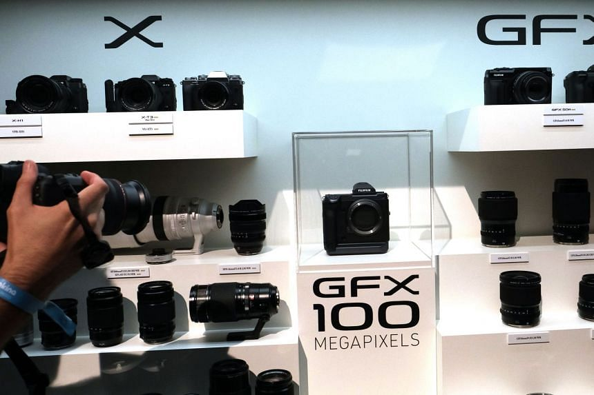 Fujifilm announced the development of GFX 100 (centre), a 102-megapixel medium-format camera at a press conference a day before the start of Photokina 2018.