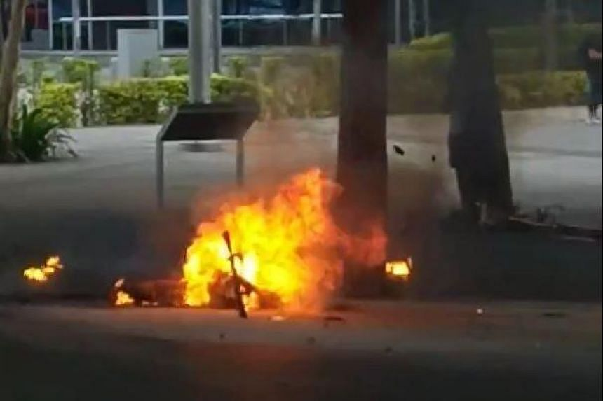 Debris was flung around Marina Boulevard after an e-scooter burst into flames outside the Red Dot Design Museum on Wednesday (Sept 26) evening.