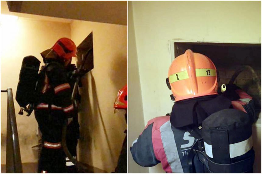 Firefighters examining a ventilation shaft in the stairwell of Tower B of Ngee Ann City. SCDF said that it extinguished a pile of smouldering trash in the shaft.