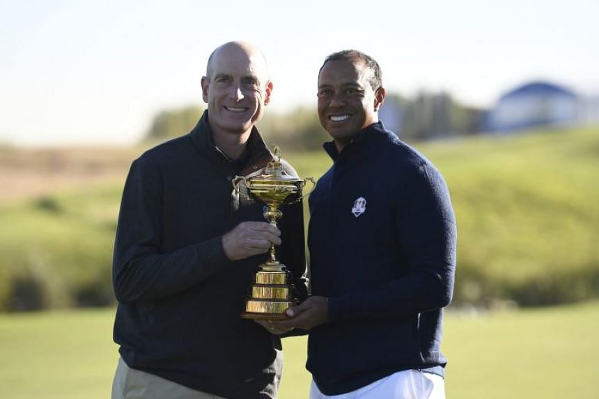 US team captain Jim Furyk (left) and US golfer Tiger Woods pose with the Ryder Cup at Saint-Quentin-en-Yvelines, Paris on Sept 26, 2018.