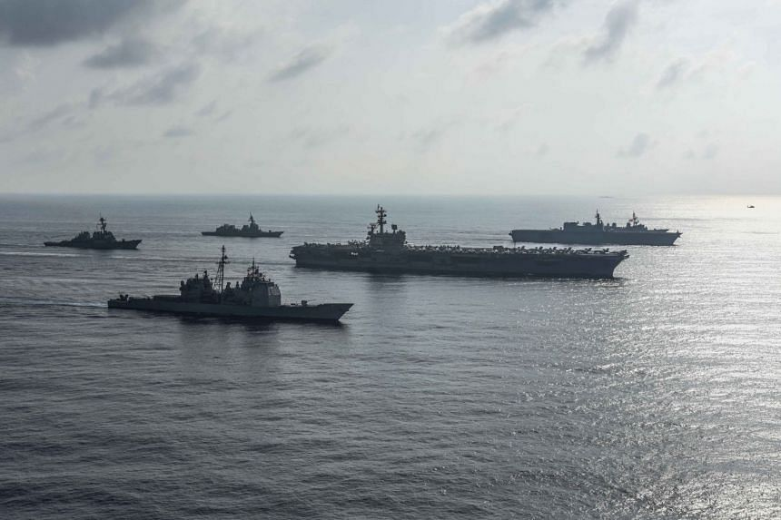 US and Japanese ships during a photo exercise in the South China Sea in August 2018.