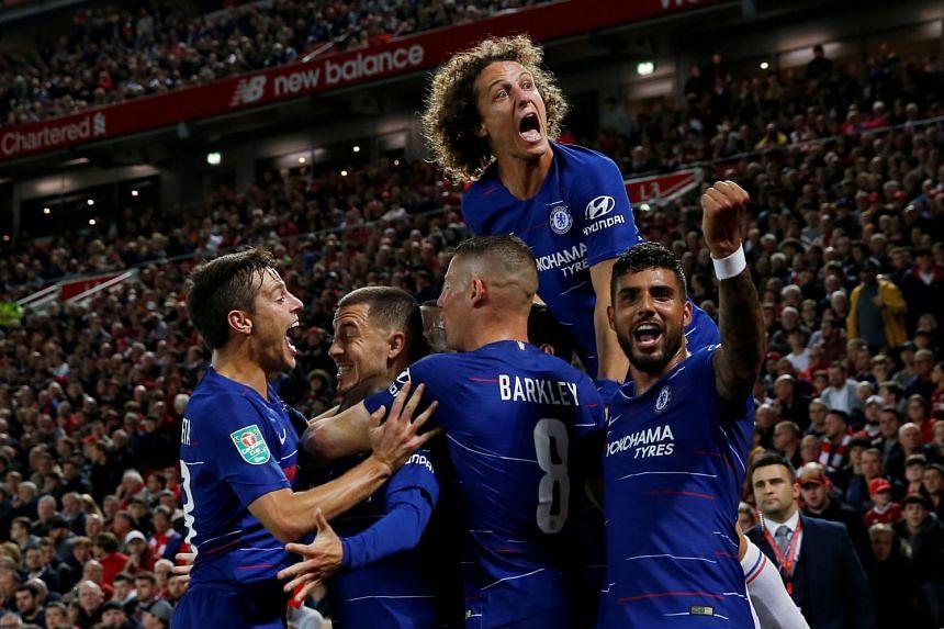 Hazard celebrates with Cesar Azpilicueta, Ross Barkley, Emerson Palmieri and David Luiz after scoring their second goal.