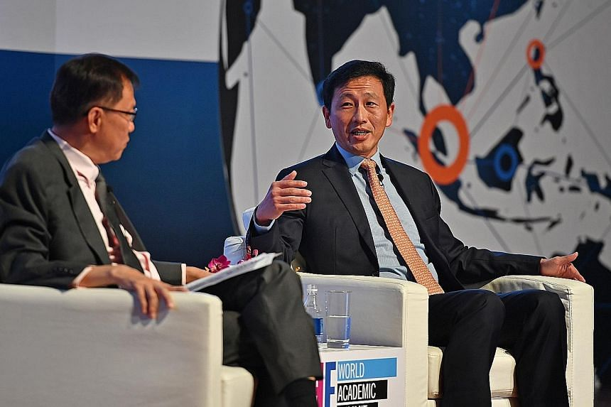 Global rankings need to go beyond just publications and citations, said Education Minister Ong Ye Kung, seen here with Professor Ho Teck Hua, who chaired a dialogue session at an education summit at NUS yesterday.