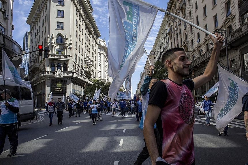 People in Buenos Aires on Tuesday protesting against runaway inflation and austerity measures imposed by President Mauricio Macri to shore up government finances. Argentina's peso has lost over half of its value so far this year, amid worries about t