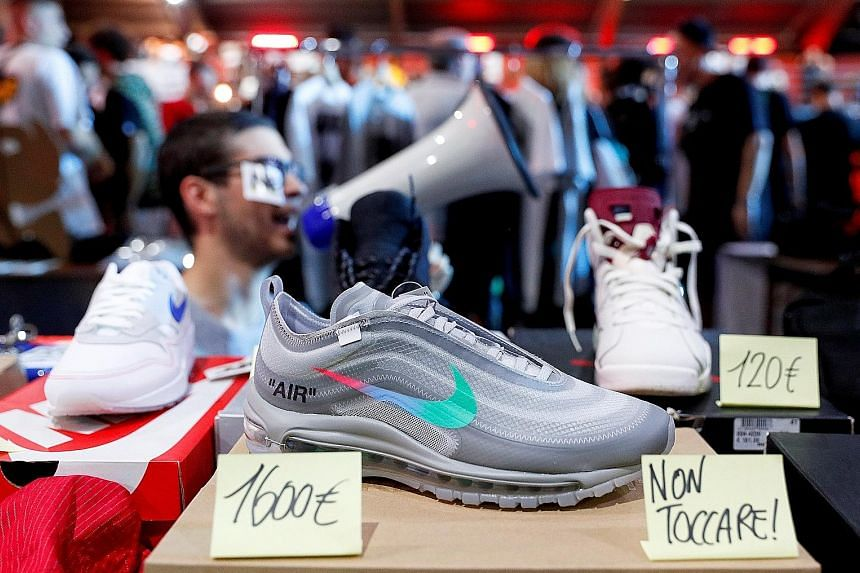 Nike shoes on sale in Rome. Its model of selling directly to consumers helped sales in North America climb 6 per cent, its second straight rise, showing signs of recovery after competition from rivals eroded sales in three out of the last four quarte
