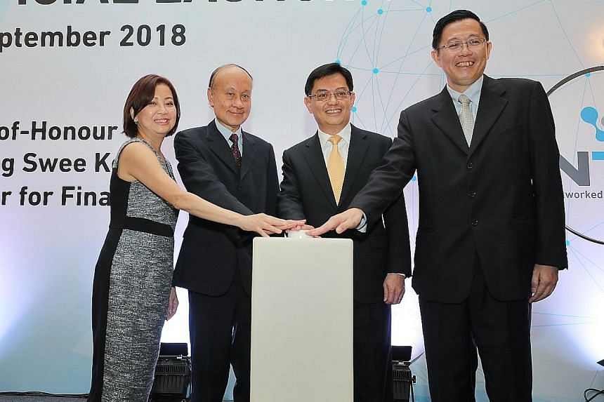 Finance Minister Heng Swee Keat (second from right) launching the new service with (from left) Networked Trade Platform Office director Serene Ho, National Trade and Logistics Inter-Agency Steering Committee co-chair Tan Kim Siew, and Singapore Custo