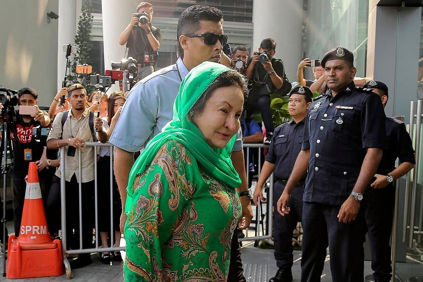 Datin Seri Rosmah Mansor, the wife of former Malaysian prime minister Najib Razak, arriving at the headquarters of the Malaysian Anti-Corruption Commission (MACC) yesterday morning. Madam Rosmah, who was accompanied by her lawyer, left the complex af