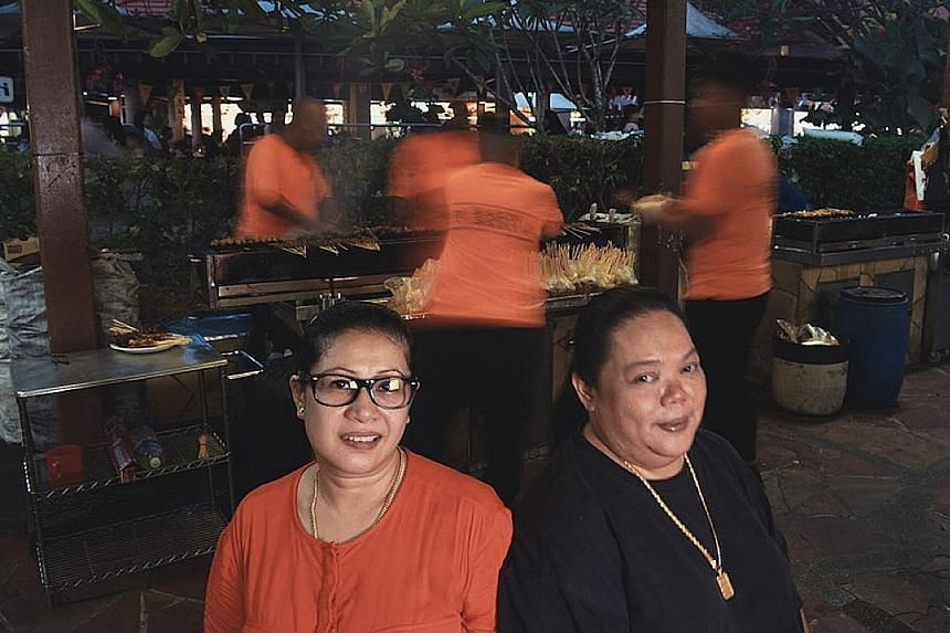 Sisters Shima Salim (left) and Harlina Haron took over their father's business in 2009. Haron Satay in East Coast Lagoon Village was named a Singapore Hawker Master by The Straits Times and Lianhe Zaobao.