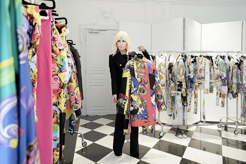 Donatella Versace in her studio in Milan last year. Her family's fashion house has been bought by American company Michael Kors.